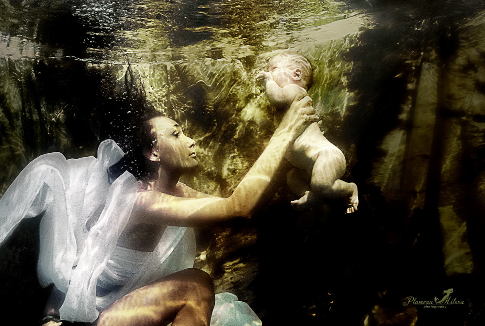 © Plamena Mileva | This is the first photograph I took in a swimming pool. My son, that he was only three months in the hands of a model, interpreting the theme of maternal love. Canon 7D with EF-S 24mm f2.8