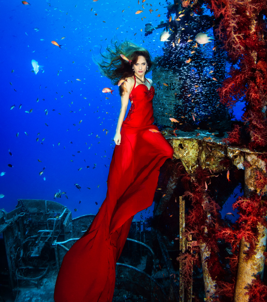 © Plamena Mileva |  Red Sea goddess woman This has been the first composition that I realized in Eilat Red sea underwater photography competition last year 2014. Almost all the photographs turned out lovely and I also then participated in other competitions with these pictures with great success. I was very lucky choosing the best model, Ellie Biel, who was impeccable. Furthermore, not many people can say they have had a photograph session in a shipwreck and wearing jewellery worth more than 100 000 $.